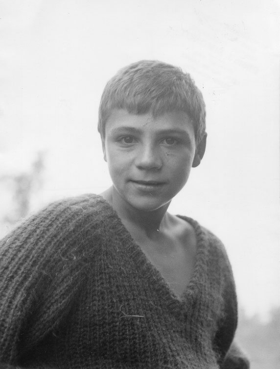 """Portrait of a boy. Vintage photograph with photographer's stamps on verso (7"""" x 9.5""""). J. SIMONOT."""