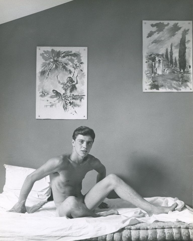 Portrait of a male nude on bed. MALE NUDE.