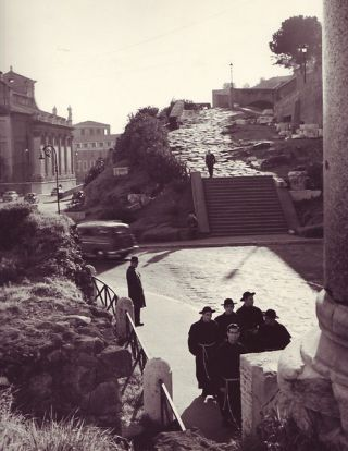 "Priests on road, Rome (9"" x 12"") photographer's stamp and penned notation on verso. Islay LYONS."
